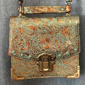 Patricia Nash turquoise & gold tooled bag.